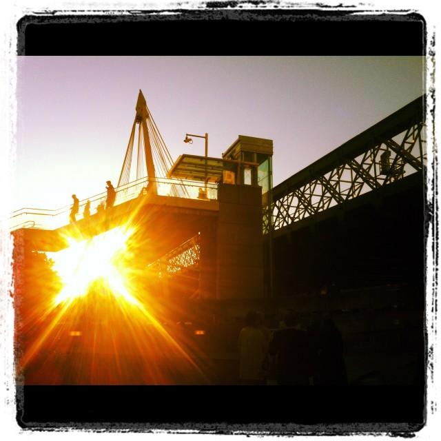 """Sun behind a London bridge"" stock image"