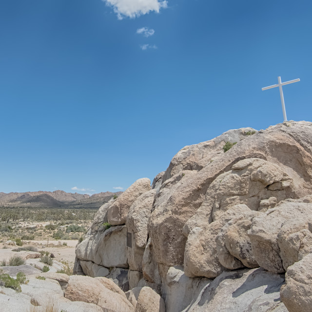 """Memorial Cross, Sunrise Rock, Mojave National Preserve, CA"" stock image"