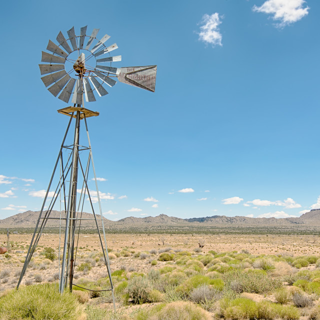 """Windmill, Holliman Well, Mojave National Preserve, California."" stock image"