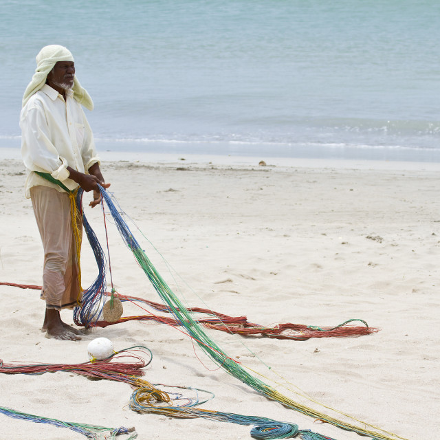 """Traditional fisherman in Uppuveli beach, Sri Lanka"" stock image"