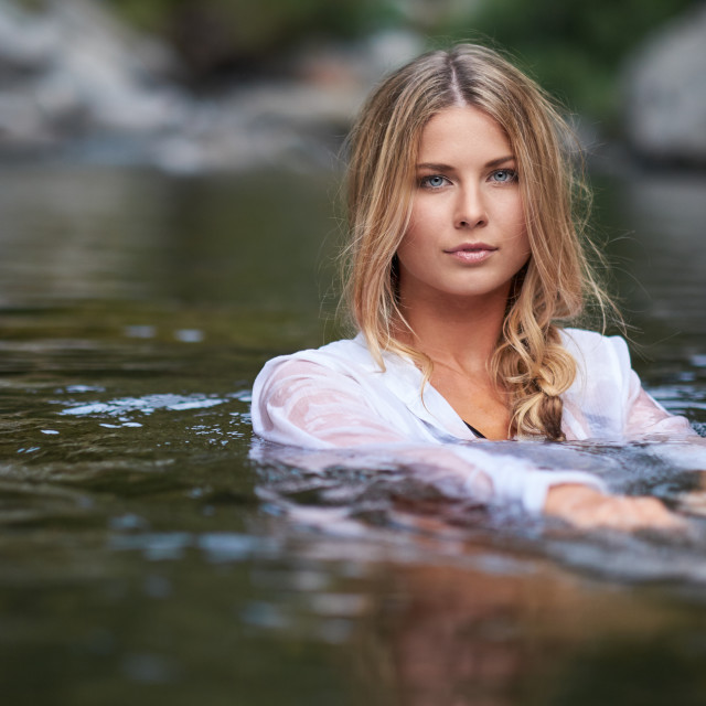 """""""A Young Woman Relaxing in A Creek"""" stock image"""
