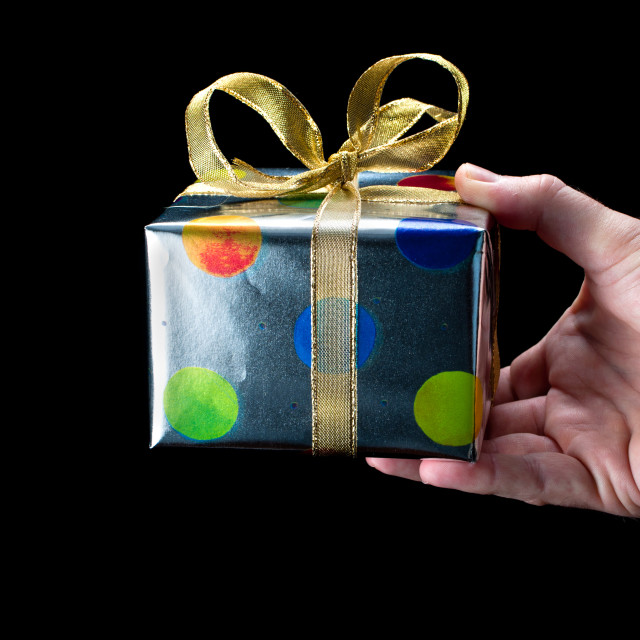 """Hand Giving a Present"" stock image"