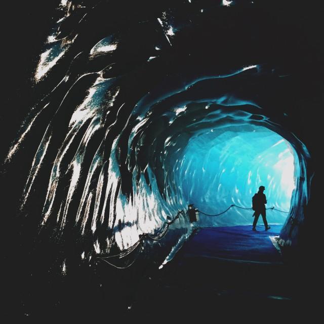 """Ice cave adventurer"" stock image"