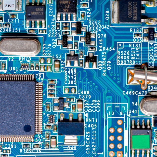 """Close-up photograph of a blue circuit board"" stock image"