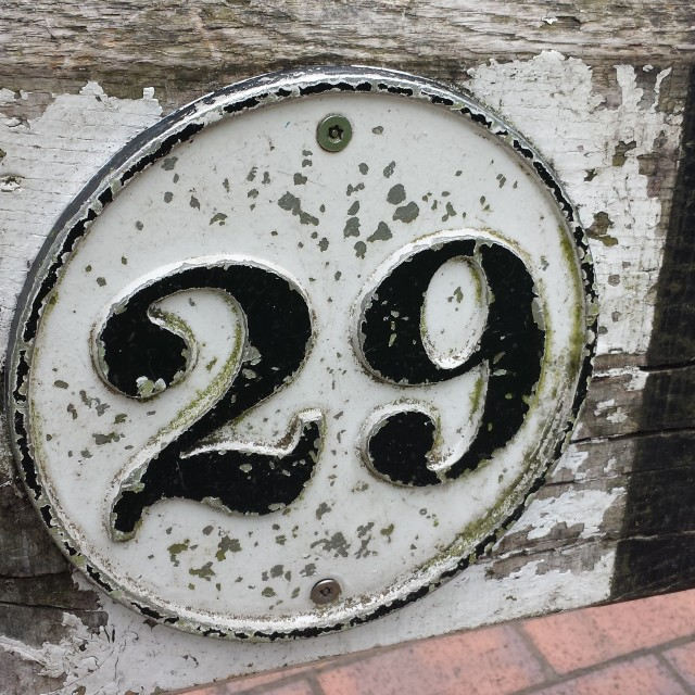 """Number 29 antique plaque."" stock image"