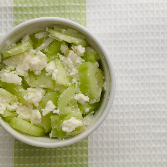 """""""Cucumber salad with fresh cottage cheese in a ramekin on a kitchen cloth"""" stock image"""