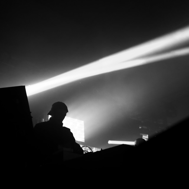"""Silhouetted DJ on stage"" stock image"