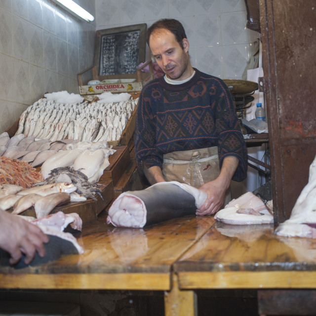 """Fishmonger slicing shark's meat"" stock image"