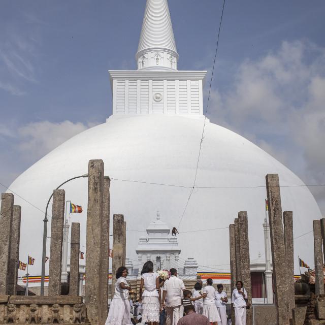 """Pelgrims at the sacred stupa at Anurdhapura, Sri Lanka"" stock image"