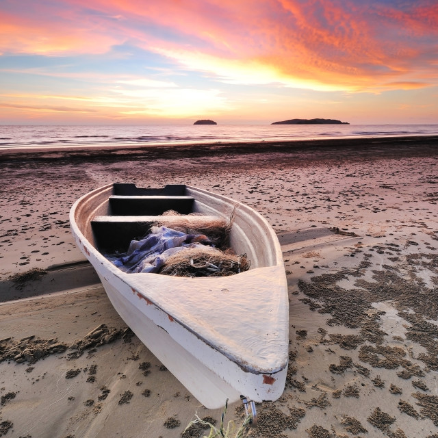 """Boat at the beach during sunset"" stock image"