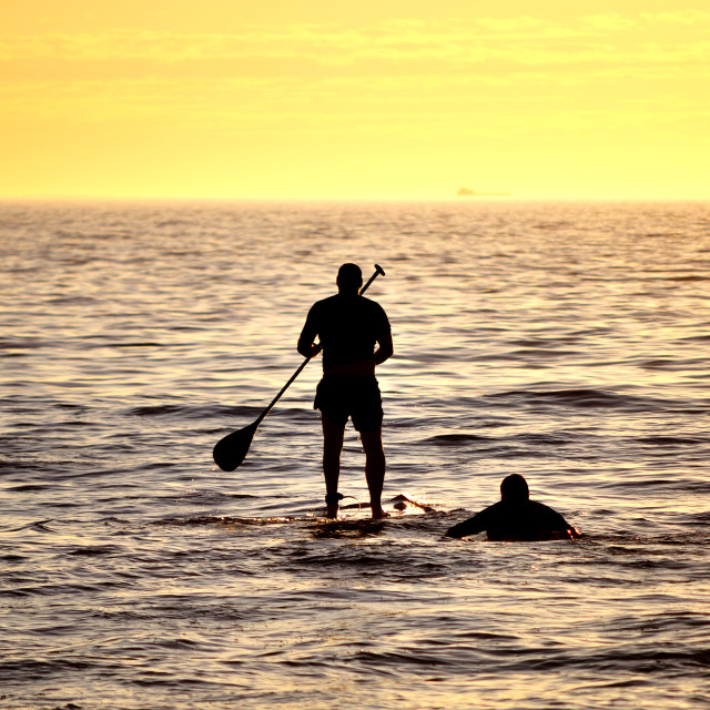"""Stand up paddler at sunset"" stock image"