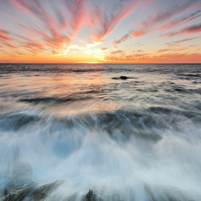 """Sunset and waves in Long exposure"" stock image"
