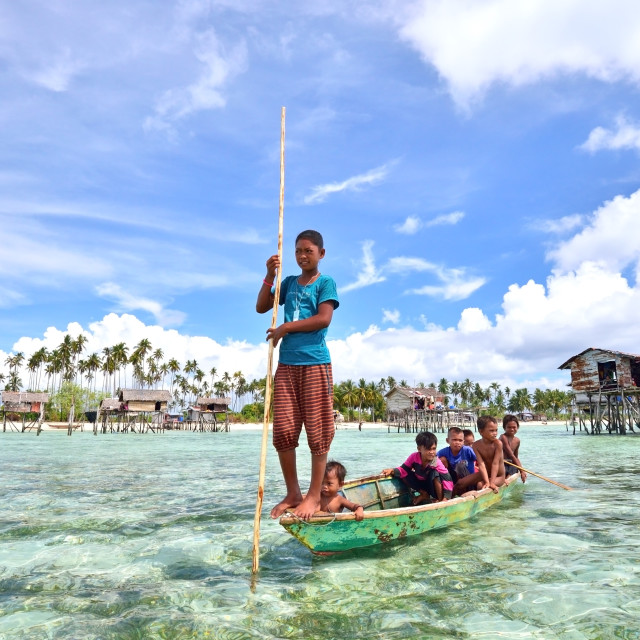 """Kids of Bajau Laut on a Boat"" stock image"