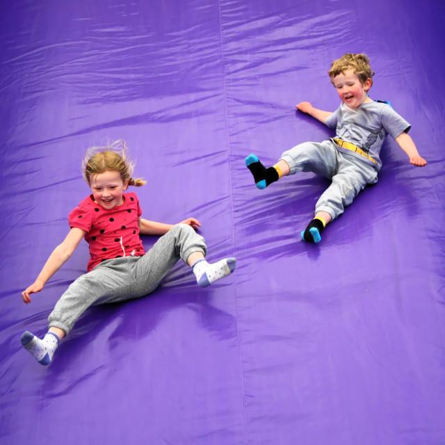 """""""Kids Having Fun on Slide"""" stock image"""