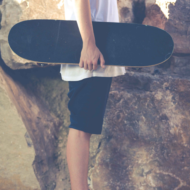 """Young boy with his skateboard"" stock image"