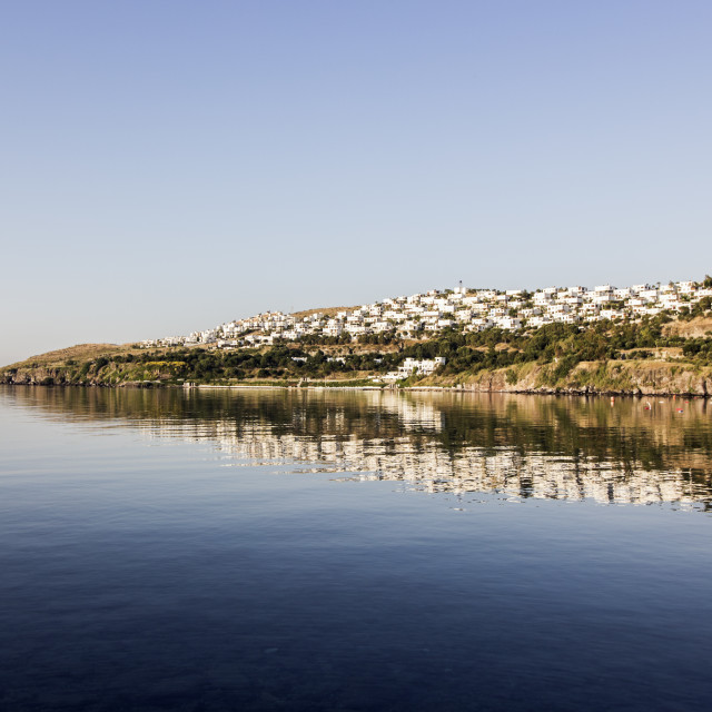 """Turkish houses on Akyarlar hillside reflected in sea"" stock image"