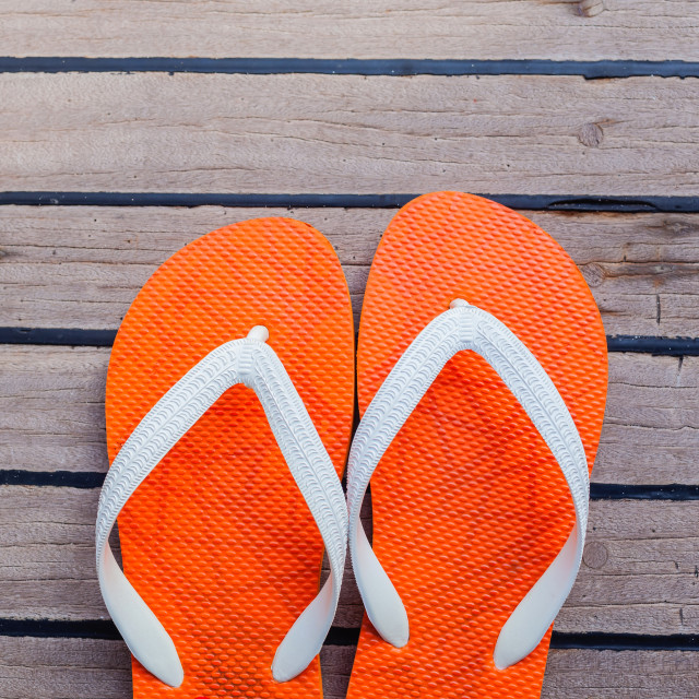 """Flip flops on sailing yacht floor for summer background ."" stock image"