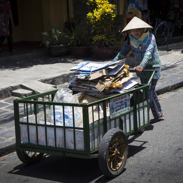 """Pushing a cart."" stock image"