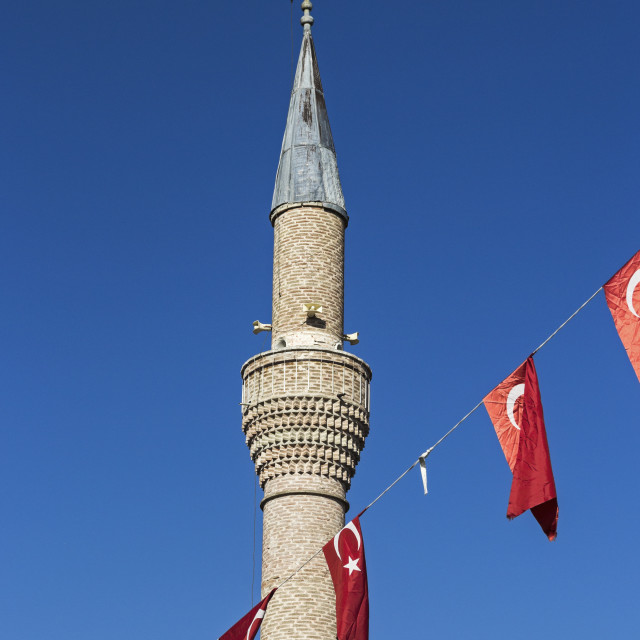 """Minaret of mosque with flags of Turkey"" stock image"
