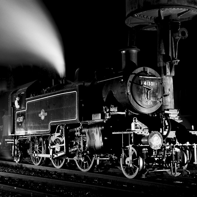 """Tank engine waiting by a water tower at night."" stock image"
