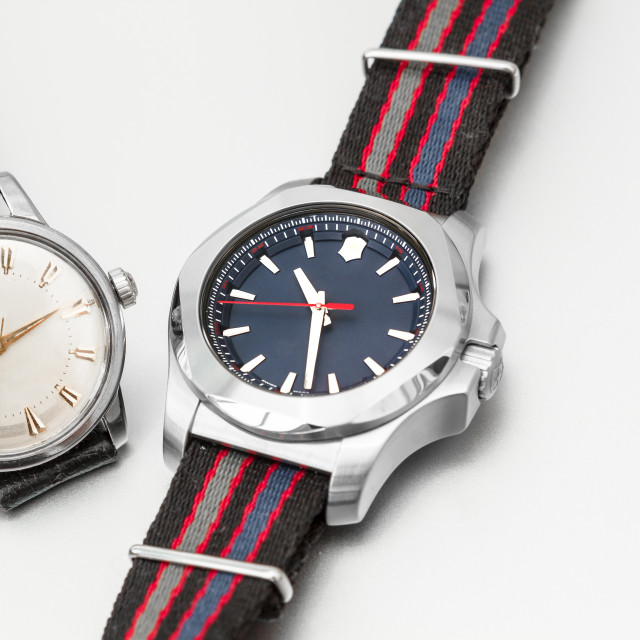 """A vintage and modern watch"" stock image"