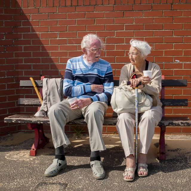 """Elderly Couple Sitting on Bench"" stock image"