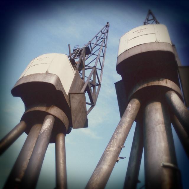 """Old Cranes, London Docklands"" stock image"