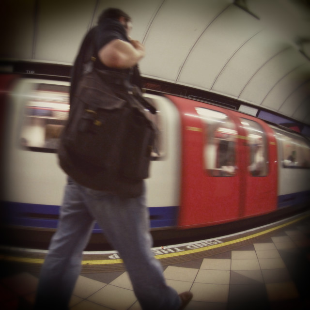 """""""Commuter walking past a moving Underground Train"""" stock image"""