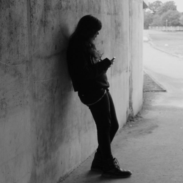 """Young lady on phone in underpass"" stock image"