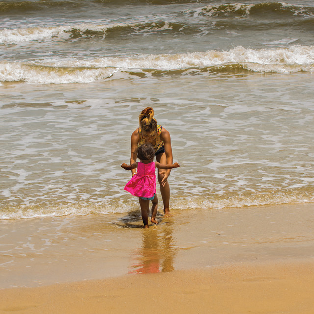"""Mother and daughter on beach"" stock image"