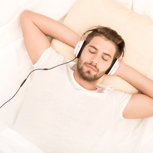 """Portrait of young man with headphones"" stock image"