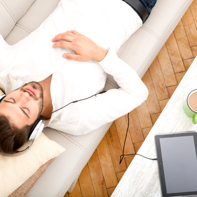 """""""Young man listening to music"""" stock image"""