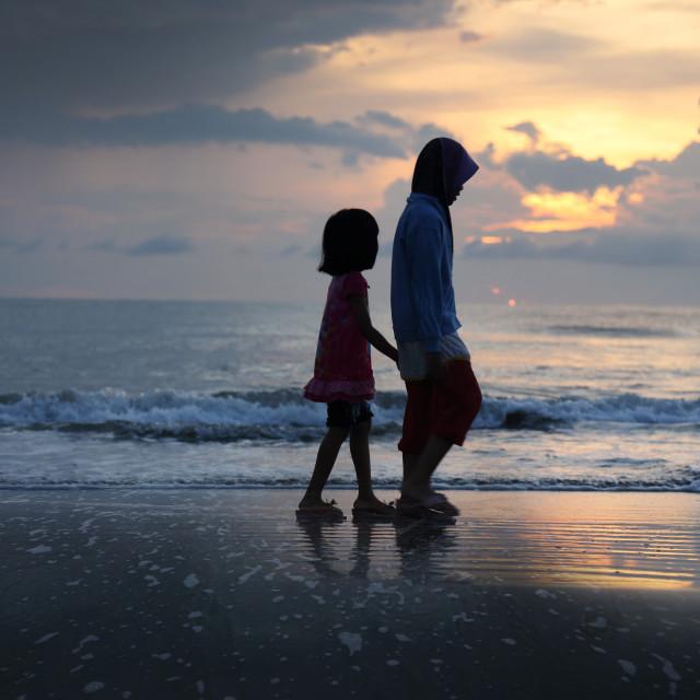 """""""2 girls walking at beach"""" stock image"""