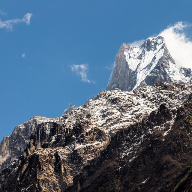 """Peak of Mount Machapuchare or popularly known as Fish Tail as viewed from Bamboo village, Nepal"" stock image"