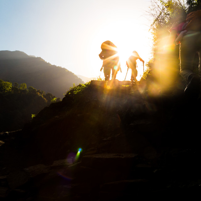 """Hiking towards sunrise"" stock image"