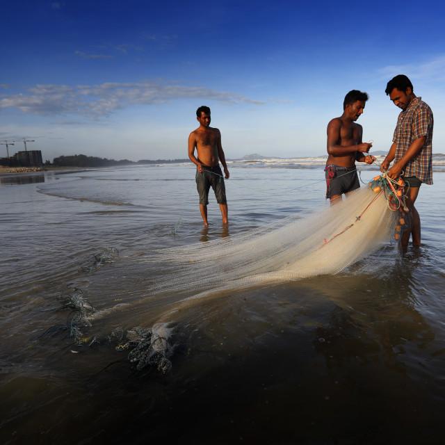 """Catching fish at beach"" stock image"