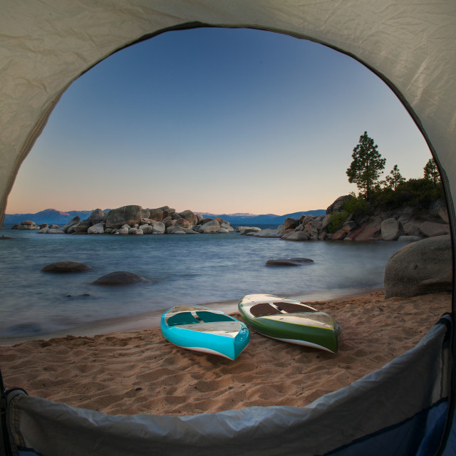 """Tent Door View of Paddle Boards on a Beach."" stock image"