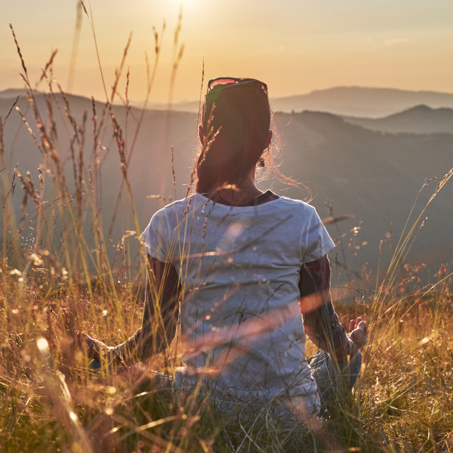 """Meditation at sunset"" stock image"