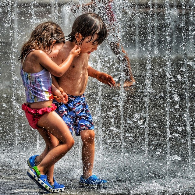 """""""Kids under the fountain."""" stock image"""