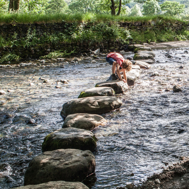 """Boy on Stepping Stones"" stock image"