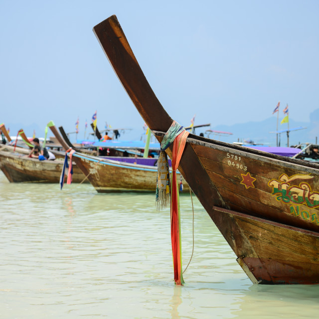 """Long tail boats on the beach"" stock image"