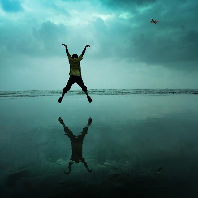 """""""Boy jumping at beac"""" stock image"""