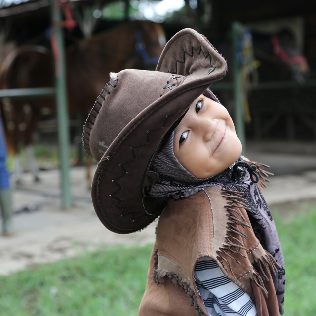 """""""A girl with cowboy attire"""" stock image"""