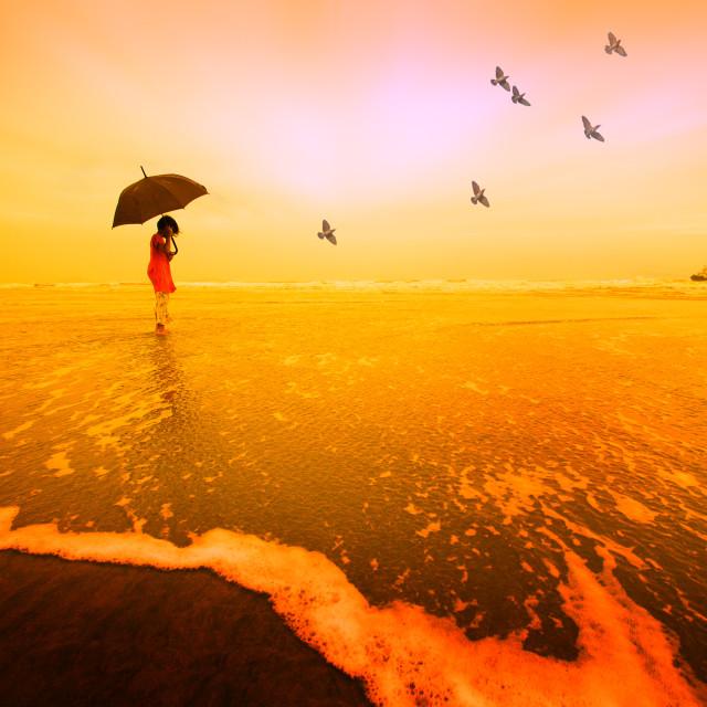 """A girl with umbrella at beach"" stock image"