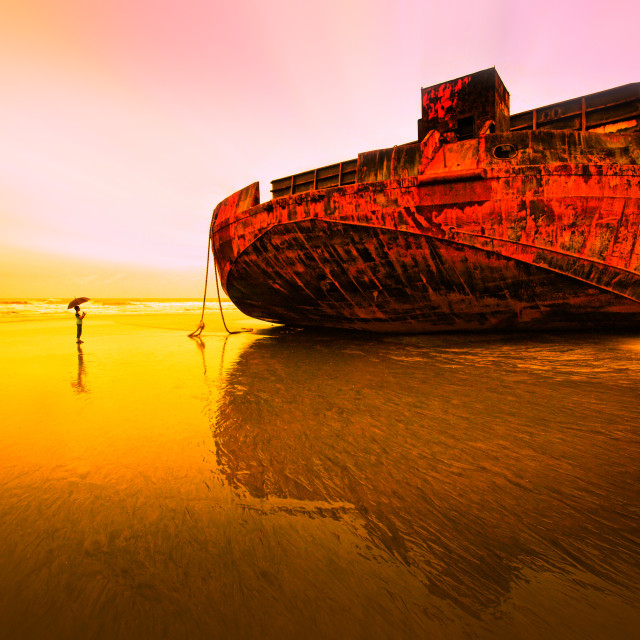 """A boy vs huge barge / ship"" stock image"