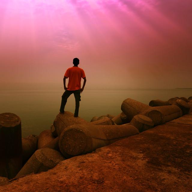 """A man standing facing sea"" stock image"