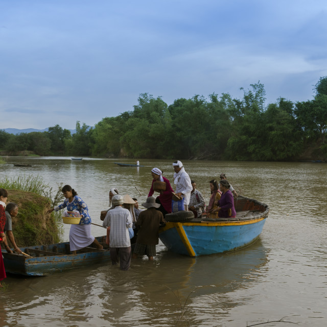 """""""The Cham people passing over the river by boat at sunrise for visiting their sanctuary land in Ramadan day on Jun 16, 2015"""" stock image"""