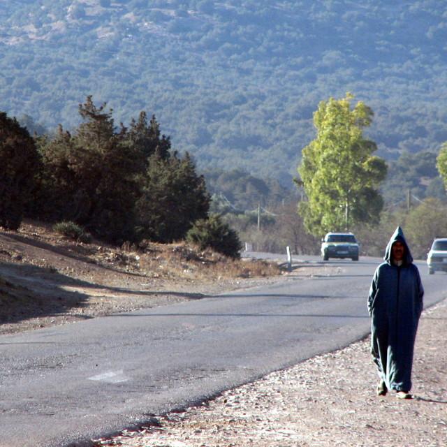 """Walking along the Agadir to Marrakech road"" stock image"