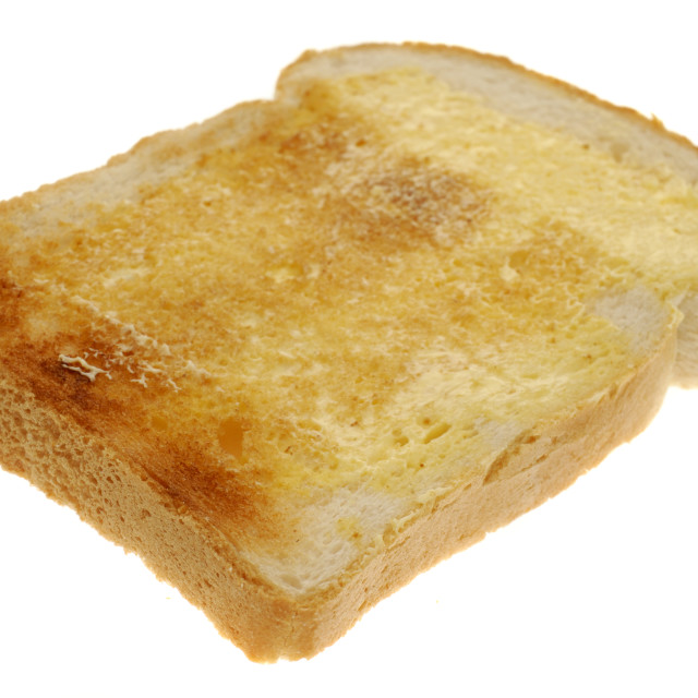 """Single Slice of Buttered Toast"" stock image"
