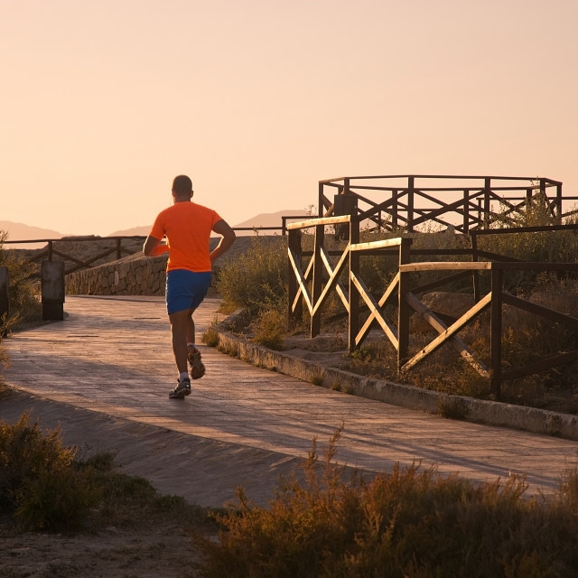 """Jogger in orange sweater"" stock image"